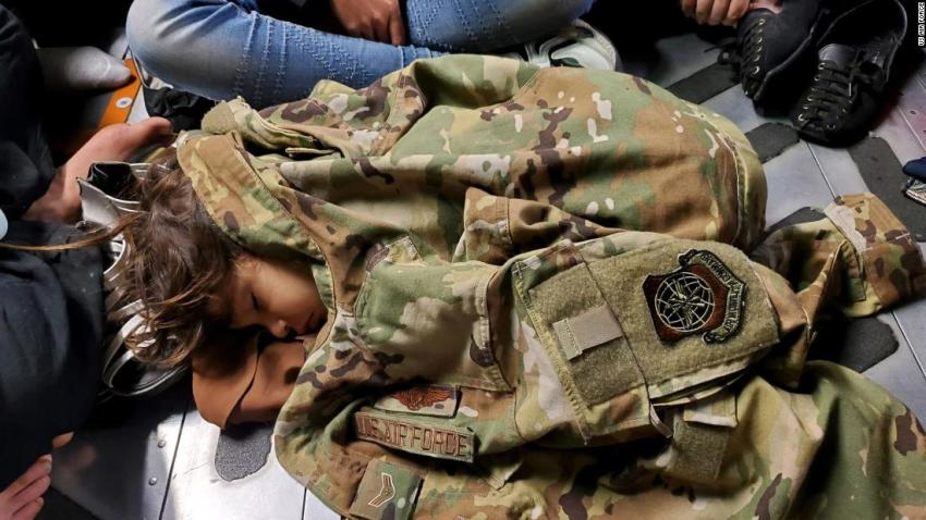 In this photo released by the US Air Force, an Afghan child sleeps on the floor of an Air Force transport plane during an evacuation flight out of Kabul on August 15.