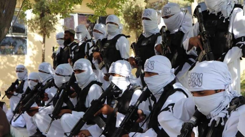 """In this photo released by the Taliban, fighters <a href=""""https://www.cnn.com/2021/08/21/politics/us-weapons-arsenal-taliban-afghanistan/index.html"""" target=""""_blank"""">brandish US assault weapons</a> at an Independence Day parade in Qalat, Afghanistan, on August 19. The Taliban's newfound American arsenal is likely not limited to small arms, as the group captured sizable stockpiles of weapons and vehicles held at strongholds once controlled by US-backed forces."""