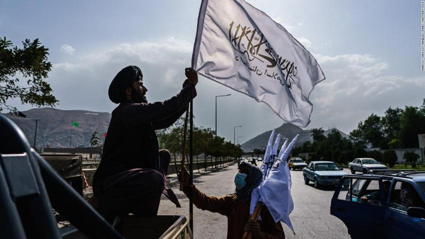 A boy sells Taliban flags to put on vehicles in the middle of a Kabul intersection on August 20.