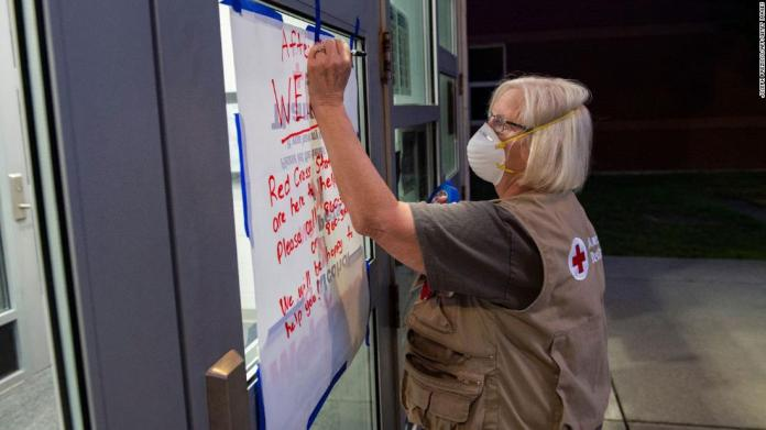 Red Cross nurse Donna Hathaway works on a welcome poster at East Lyme Middle School, which has been serving as a shelter in New London, Connecticut, on August 21.