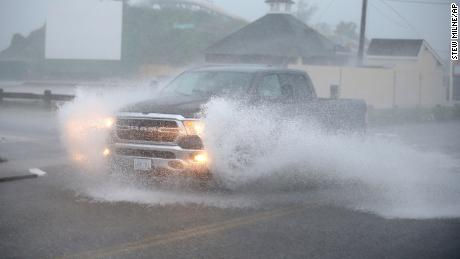 A truck drives through a flooded Atlantic Ave in Westerly, Rhode Island, as Tropical Storm Henri approaches on Sunday, Aug. 22.