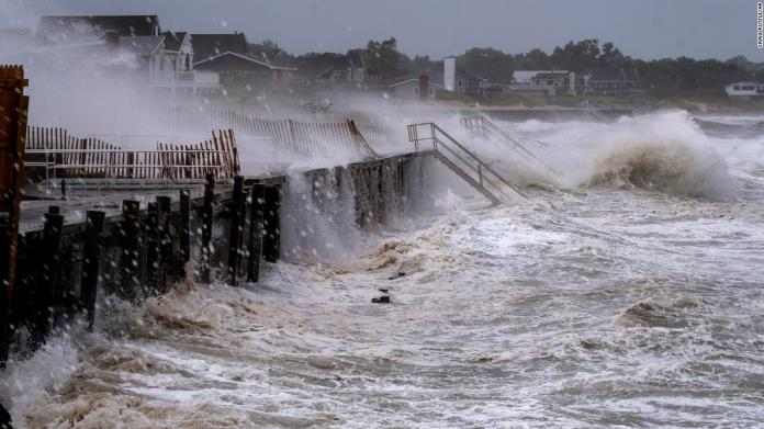 Waves pound a seawall in Montauk, New York, on August 22.