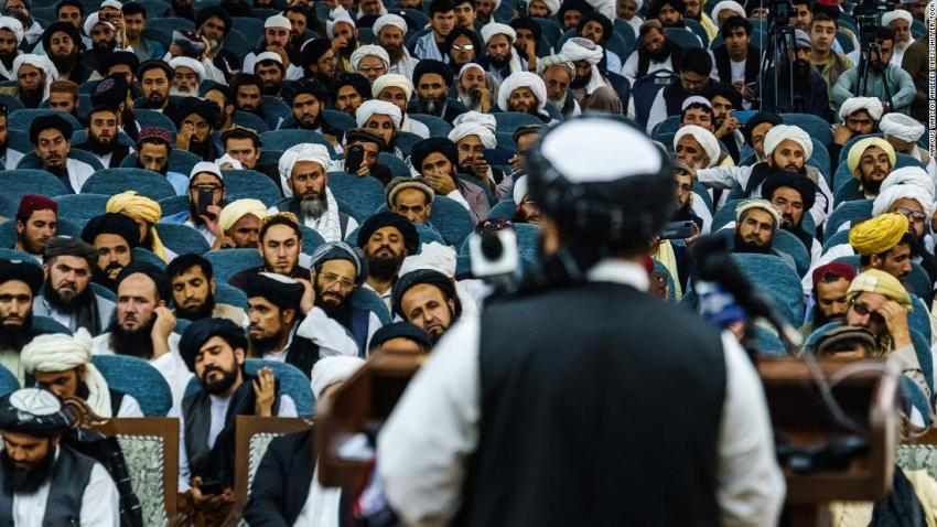 Zabihullah Mujahid, a spokesman for the Taliban, addresses hundreds of religious leaders who were attending an event held by the Taliban's Preaching and Guidance Commission on August 23.
