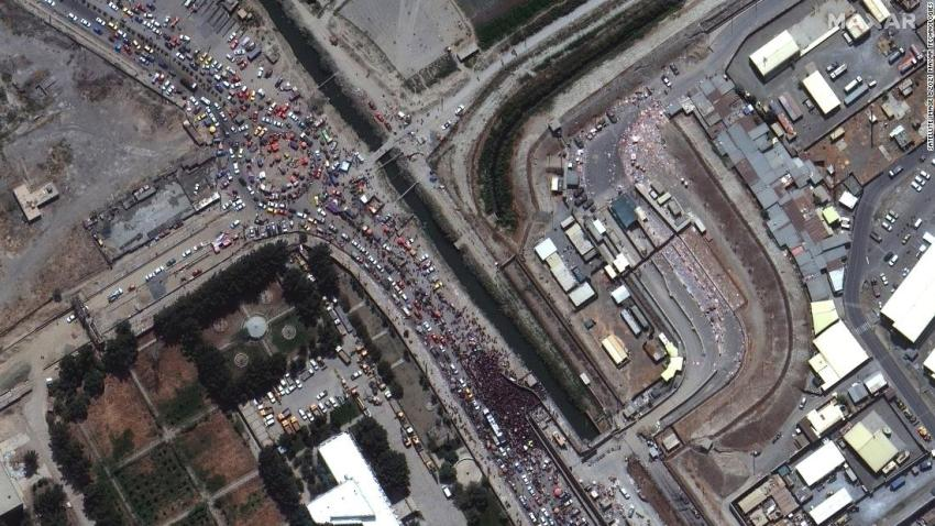 """This satellite image shows crowds gathered outside a gate to the international airport in Kabul on August 23. Western countries were in <a href=""""https://www.cnn.com/2021/08/23/asia/kabul-airport-afghanistan-intl-hnk/index.html"""" target=""""_blank"""">a frantic race</a> to complete what US President Joe Biden called """"one of the largest, most difficult airlifts in history."""""""