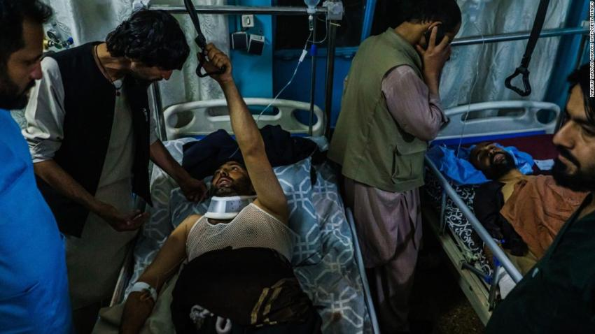 People who were injured in the August 26 suicide bombing are visited by family members at a hospital in Kabul.