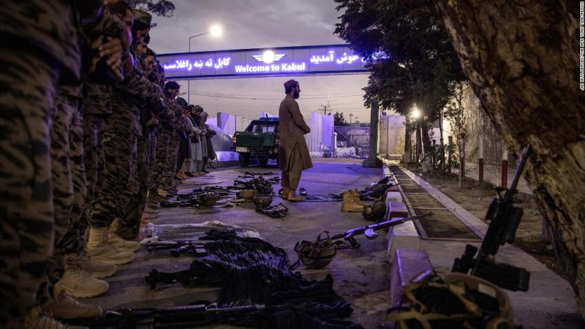 Members of the Badri 313 Battalion, a group of Taliban special forces fighters tasked with securing the area surrounding the Kabul airport, perform evening prayers on August 28.