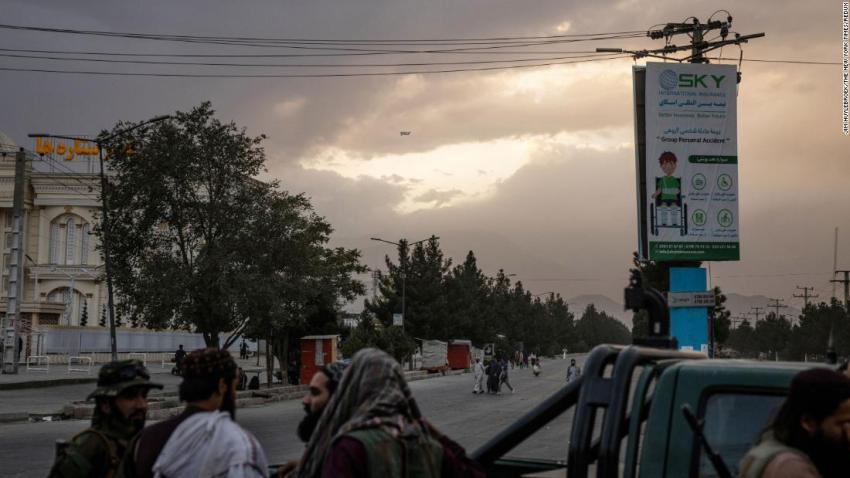 A C-17 military transport plane is a dot in the sky as it leaves Kabul on August 30.