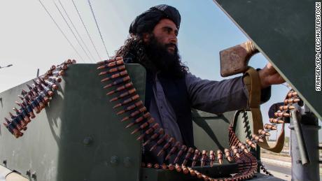 A Taliban fighter parade through Kandahar seizes American weapons.