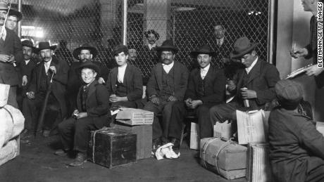 A group of Italian immigrants ready to be processed at Ellis Island in New York in 1905.