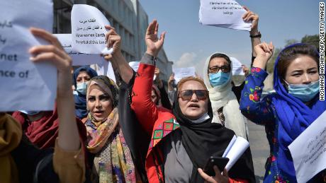 Afghan women take part in a protest march for their rights under the Taliban rule in the downtown area of Kabul on Friday.