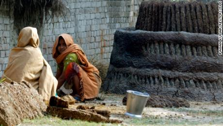 Dalit women work with cow dung on the outskirts of Lucknow in 2008.