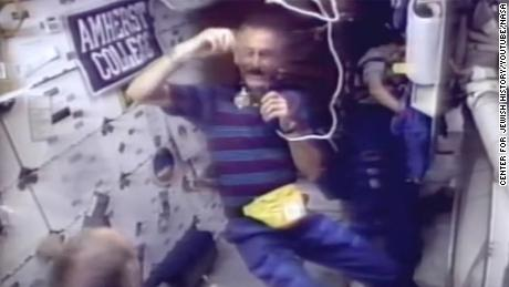 Jeffrey Hoffman, NASA's first Jewish male astronaut, seen spinning a dreidel during a shuttle mission in 1993.