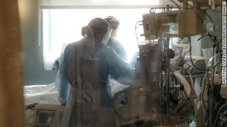 Nurses check on a patient in the ICU Covid-19 ward at NEA Baptist Memorial Hospital in Jonesboro, Arkansas, on August 4, 2021.