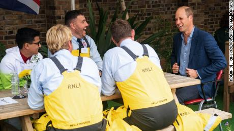 Prince William speaks with Royal National Lifeboat Institution crew in London on September 9.