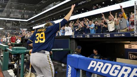 Starting pitcher Corbin Burnes of the Milwaukee Brewers waves to fans as he leaves the field after throwing a combined no-hitter to defeat the Cleveland Indians on Saturday.