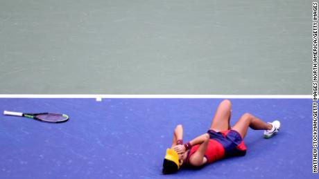Raducanu celebrates winning championship point to defeat Fernandez.