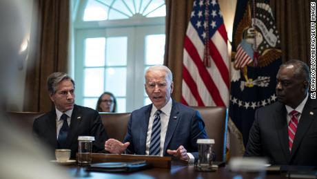 President Joe Biden speaks as Antony Blinken, secretary of state, left, and Lloyd Austin,  secretary of defense, right, listen during a cabinet meeting at the White House, July 20, 2021.