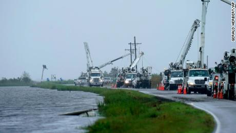 Utility crews replace power poles destroyed by Hurricane Ida in Pointe-aux-Chenes, Louisiana, on September 14, 2021.