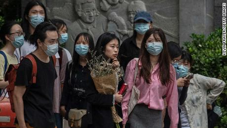 Zhou Xiaoshuan, also known as Jianzhi, stands with supporters outside a Beijing court on September 14.