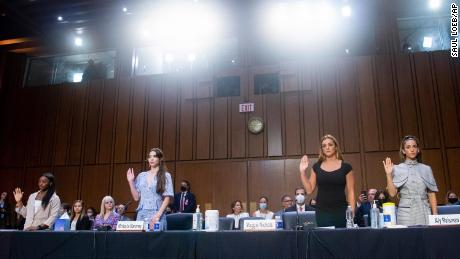 From left, United States gymnasts Simone Biles, MacKayla Maroney, Maggie Nichols and Aly Raisman were sworn in to testify during a Senate judiciary hearing about the Inspector General's report on the FBI's handling of the Larry Nassar investigation.