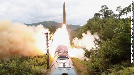 A North Korean missile is launched from a train on September 15, 2021, during a test.