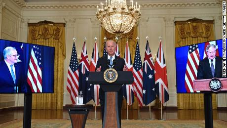US President Joe Biden talks about national security with British Prime Minister Boris Johnson, on the right, and Australian Prime Minister Scott Morrison, on the left, in the East Room of the White House in Washington, DC, on 15 September.