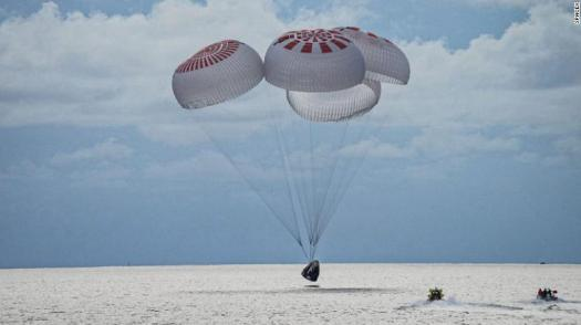 The SpaceX Crew Dragon capsule splashes down into the ocean off the coast of Florida.