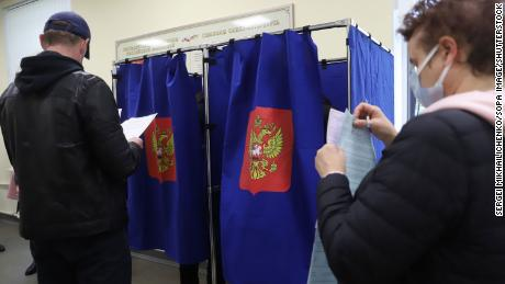 People vote during the last day of the three-day parliamentary and local elections in Russia.