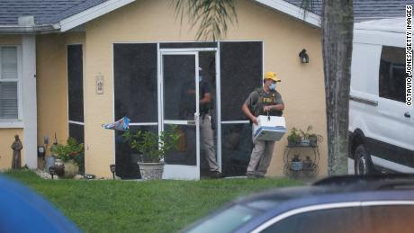 FBI agents snatch possible evidence from Brian Laundry's family home in North Port, Florida, on September 21, 2021.