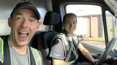 Triton Transportation owner Ryan Schmutzer, left, rides in a delivery van with former driver Branden Fletcher.