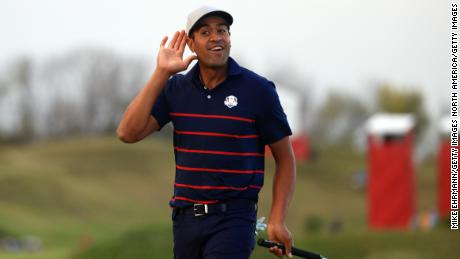 Tony Finau celebrates after winning the foreball match on Friday afternoon.