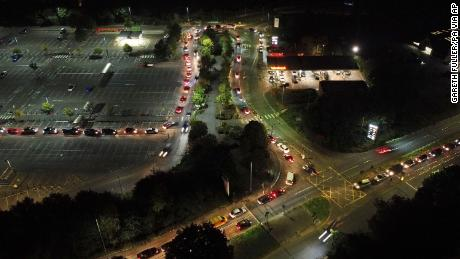Motorists queue to fill their cars at a Sainsbury's fuel station in Ashford, England,  Saturday, September 25.