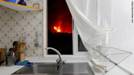 Lava is seen through the window of a kitchen from El Paso on September 28, 2021.