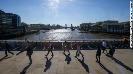 Travelers walk on London Bridge on 27 May.