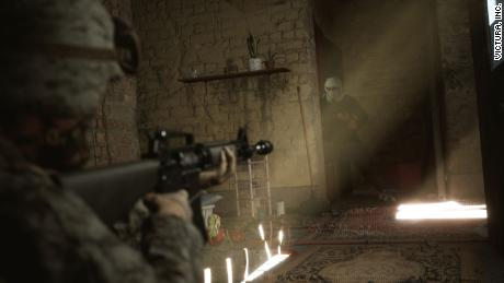 """a view of """"Six Days in Fallujah"""" Shows a US soldier aiming his weapon at an Iraqi man wearing a traditional headdress."""