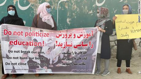 Women return to work, school and the streets in Kabul to protest the Taliban