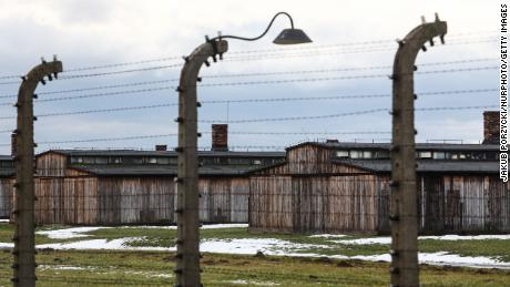 Barbed wires and camp barracks at former Nazi German concentration camp Auschwitz-Birkenau on January 23, 2021.