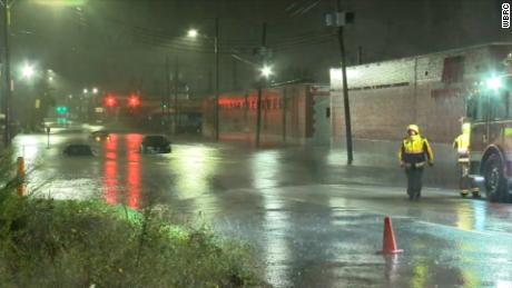 Vehicles are stranded in a flooded area of Birmingham, Alabama.