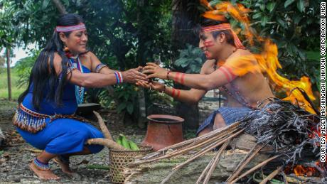 Traditionally the Shuar people have been self-sufficient and self-governing. Pictured is Sayda Unkuch with her son Kaar Mashingashi in Chumpias, Ecuador.