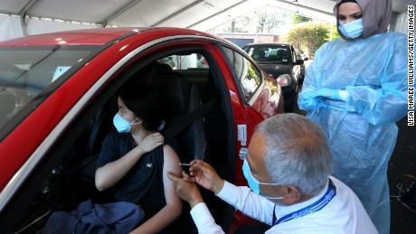 A doctor administers the Pfizer vaccine to a client at the Belmore Sports Ground vaccination hub on October 3 in Sydney, Australia.