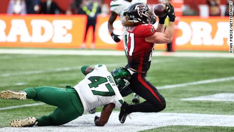 Hurst makes a touchdown catch against the Jets.
