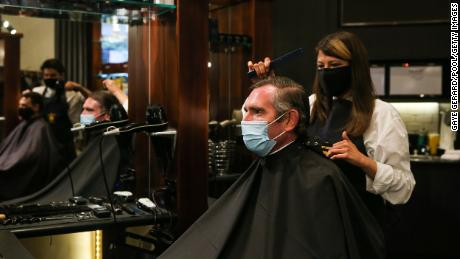 NSW Premier Dominic Perrottet receives a haircut on October 11, following the easing of Covid-19 restrictions in the state.