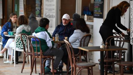 Diners sit at a cafe in Sydney, Australia on October 11 as the city emerges from lockdown.