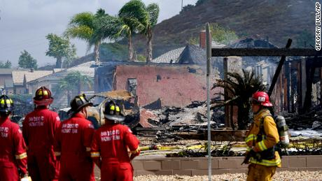 Several homes were damaged in the flames when the Cessna plane crashed.