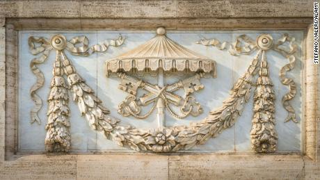 The arms of the Holy See on the facade of the Basilica of Saint John Lateran in Rome in November 2017.