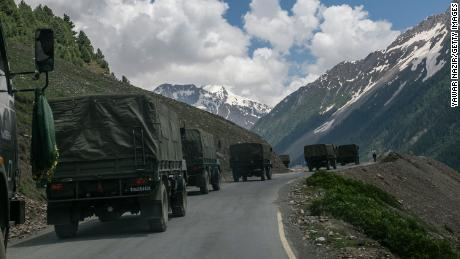 An Indian Army convoy passes through Joji La, a high mountain pass bordering China, in Ladakh, India, on June 13.