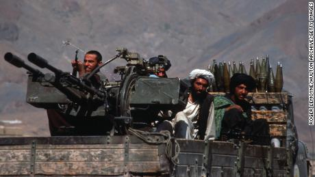 Taliban militiamen ride in a heavily armed vehicle October 10, 1996 in Kabul, Afghanistan.