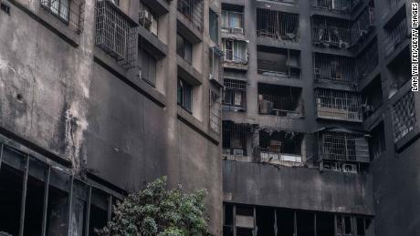 The exterior walls of a residential building stands charred in the wake of a fire on October 14, in Kaohsiung, Taiwan.