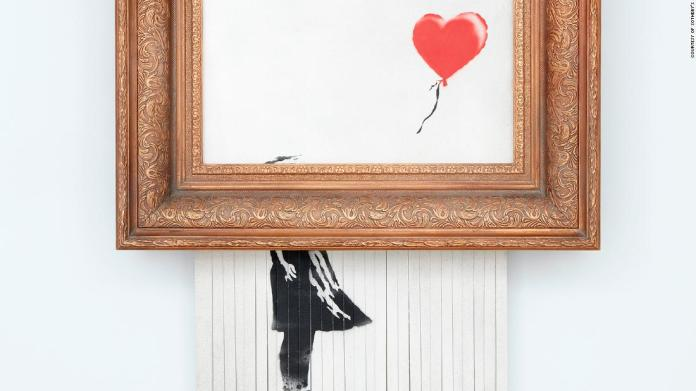 Watch Second sale of Banksy's shredded portray units staggering new file at .4 million – Google Entertainment News