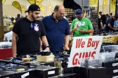 Gun enthusiasts attend the South Florida Gun Show at Dade County Youth Fairgrounds in Miami, Florida, on February 17, 2018. (Photo by MICHELE EVE SANDBERG/AFP via Getty Images)